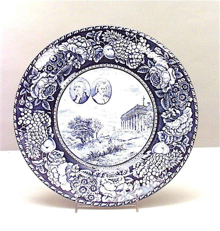 Set of 15 English blue and white porcelain dinner plates with American historical scenes (Staffordshire, 20th century).