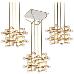 Set of 16 Swiss Chandeliers in Brass