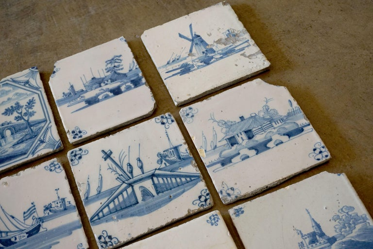 This set of blue and white tiles depict French country life in the 1600s.   A total of 17. Each tiles measures 5.25 x 5.25 inches.