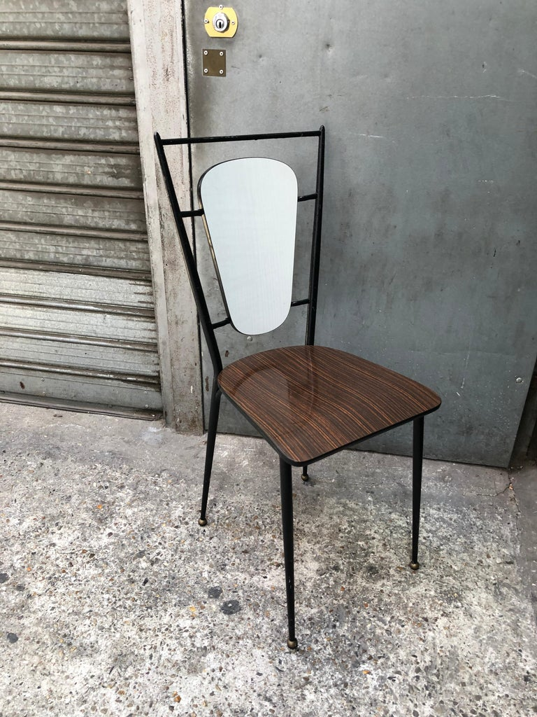 Iron and formica chairs from the 1960s.