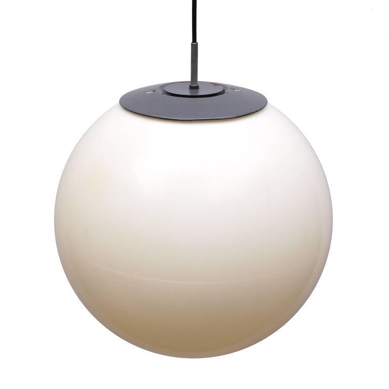A set of 1960s three large adjustable ball hanging lights in white plastic with metal top fixings.