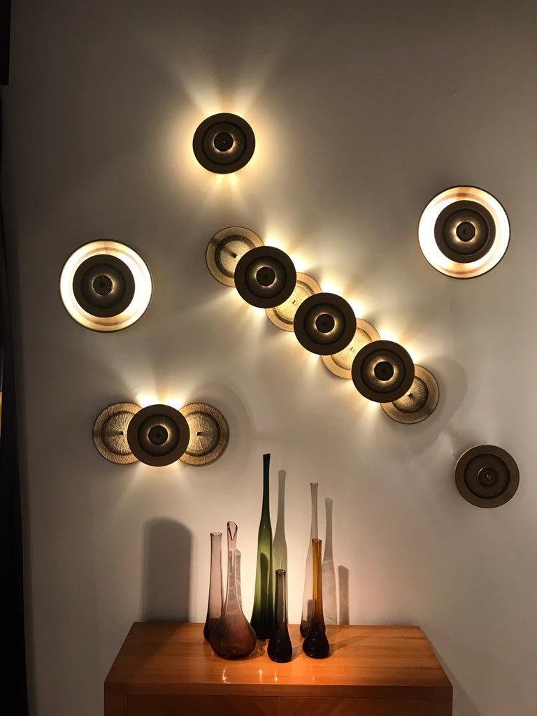 6 ceramic wall lights by Soholm Designed by Noomi Backhausen and Poul Brandborg Original Label for this vintage pieces in great condition  Denmark circa 1970  Dimensions: small single: 25 cm diameter med single :37 cm diameter 3 disc: 55cm x