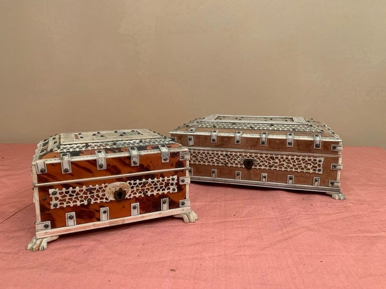 Set of 2 Anglo Indian boxes. Both early 20th century with bone and faux tortoise decorations. In overall good condition. The bone of the back from the larger box is absent and some small losses.