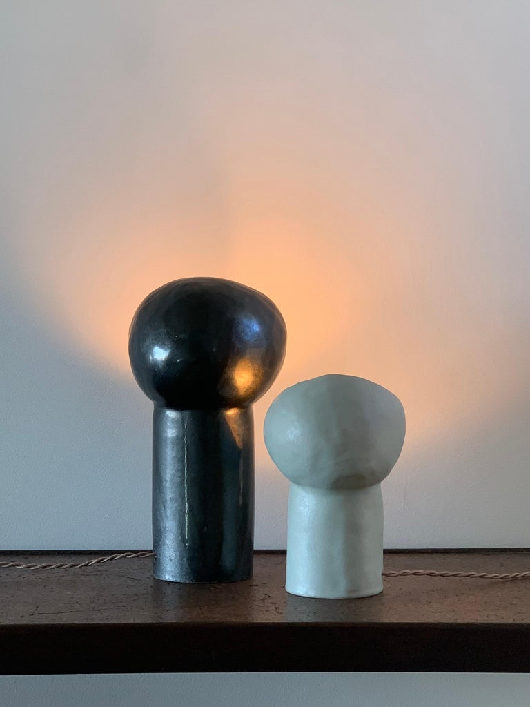 Glazed Set of 2 Black and White Cyclope Light Sculptures For Sale