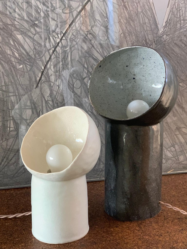 Ceramic Set of 2 Black and White Cyclope Light Sculptures For Sale