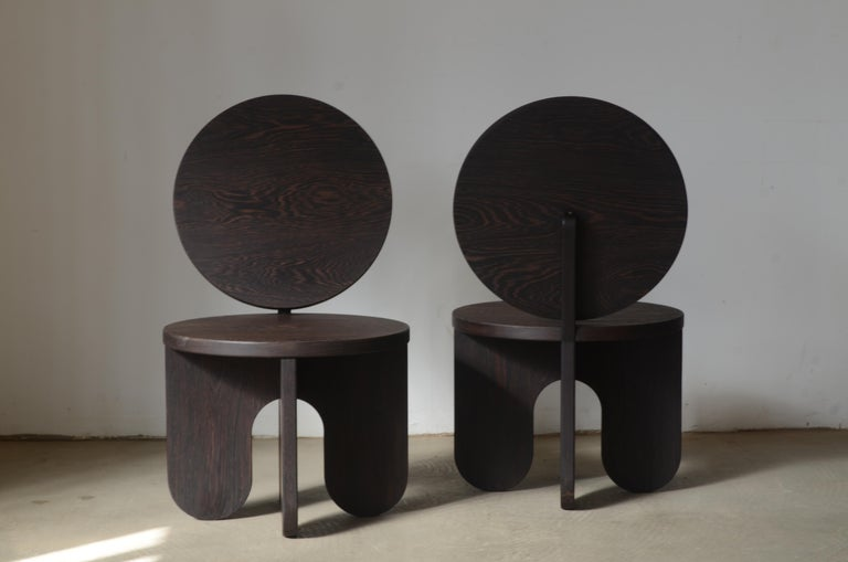 Set of 2 Capsule lounge chairs by Owl Dimensions: H 90 x W 52 x D 60 cm  Seat H: 40 cm Materials: Solid wood  The design of this series is open to being produced in various materials. As a base, we've chosen solid wood, lacquered MDF and