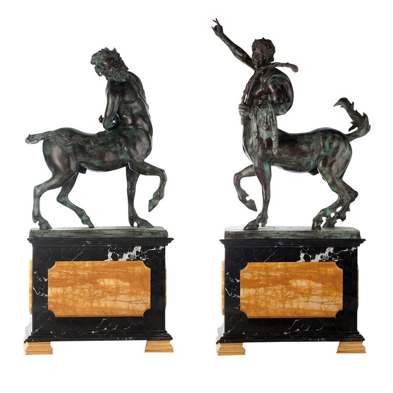 These two statuettes are inspired by ancient mythology and depict the traditional centaur, half man and half horse. Each statue rests on a classically-shaped pedestal in black marble with striking inserts and feet in yellow marble. The bronze