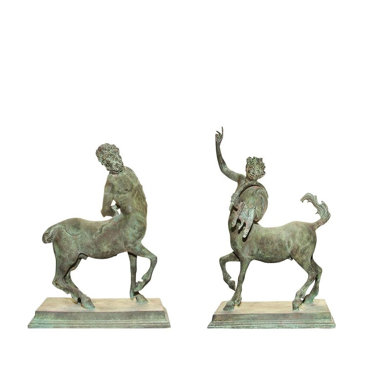 This elegant set in bronze depicts two centaurs in classical poses, exquisitely depicted using the lost-wax casting technique, with particular attention to details such as the hair, finely rendered in bas relief on the body of the torso and on the