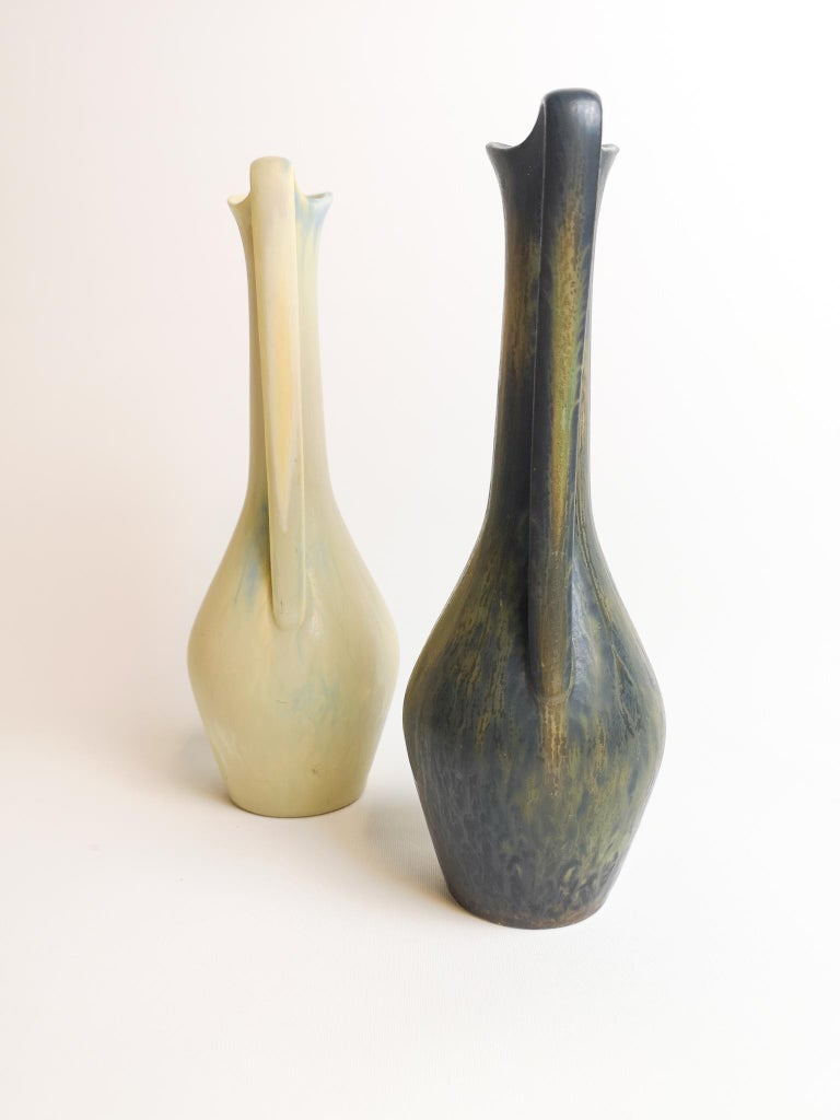 Two wonderful vases from Rörstrand and maker/Designer Gunnar Nylund. Made in Sweden in the midcentury. Beautiful glazed vases in good condition.   Measures H 24 x D 8cm.