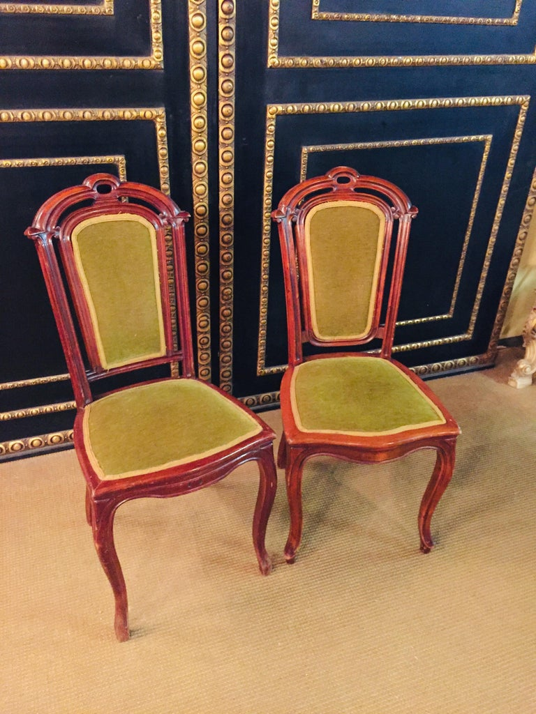 Solid wood mahogany. Beautiful set of 2 chairs from the late Biedermeier period. Curved legs.