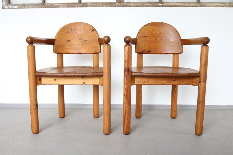 Wonderful set of two very sculptural dining room chairs in pine wood by Swedish architect and designer Rainer Daumiller, manufactured by Hirtshalls Sawmills. Notice the beautifully carved organic lines of the seats and the general natural feel of