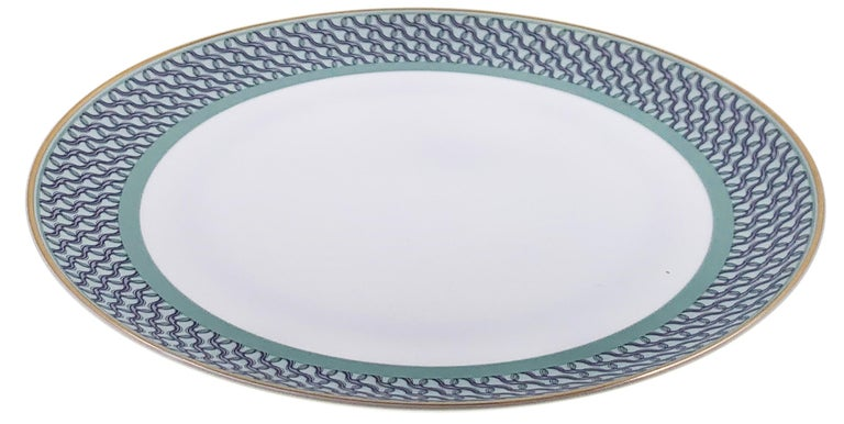 Larger quantities available upon request, with 8 weeks production time.  Description:Set of 2 dinner plate with ring pattern (2 pieces) Color: Sage green Size: 26.5Ø x 2.5H cm Material: Porcelain and gold Collection: Mid Century Rhythm