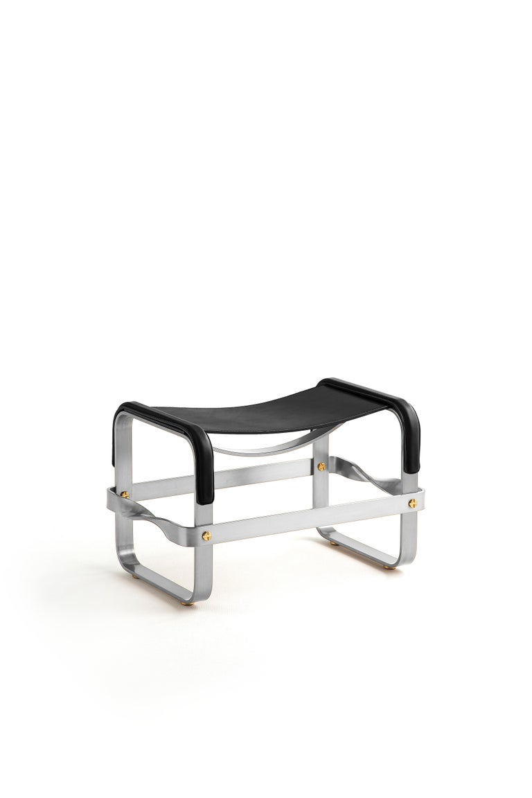 The Wanderlust contemporary ottoman and footstool belongs to a collection of minimalist and serene pieces where exclusivity and precision are shown in small details such as the hand-turned metal nuts and bolts that fix the leather surfaces, that go