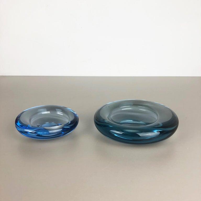 Article:  Glass bowl elements set of 2   Design:  Per Lütken   Producer:  Holmegaard, Denmark.   Age:  1960s   Description:  Set of 2 wonderful heavy glass elements designed by Per Lütken and produced by Holmegaard in Denmark