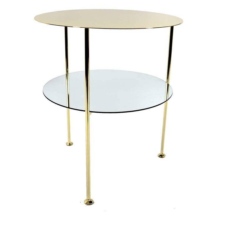 A modern interpretation of a traditional design, these coffee tables are a stunning complement to the Sotow chairs. It boast a stunning three-legged iron structure that was handmade and plated with 24-karat gold and features elegant galvanized feet