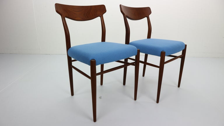 Set of 2 Harry Østergaard dining chairs produced by Randers Møbelfabrik, Denmark in the early 1960s. These airy designed chairs are made of solid teak with beautifully handcrafted wood connections. These chairs are high quality. The organically