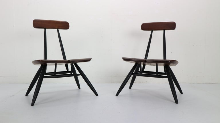 Rare Pirkka lounge chair pair designed by Ilmari Tapiovaara and manufactured by Laukaan Puu, Finland 1955. This pair of lounge chairs from the Pirkka series is quite rare and it's the only model that was not put back in production. The chairs have a