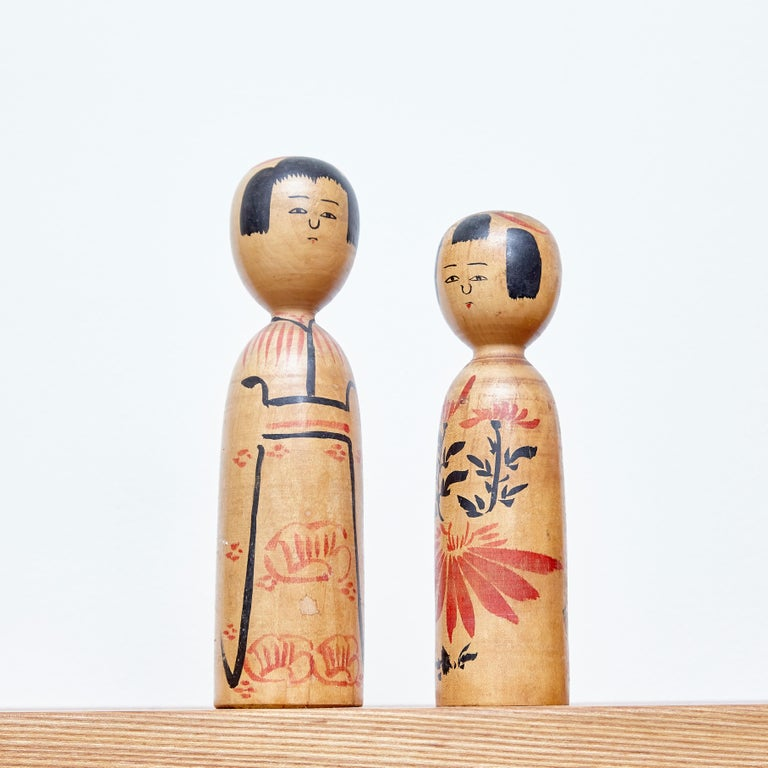 Japanese doll called Kokeshi of the late 20th century. Provenance from the northern Japan. Dolls shapes and patterns are particular to a certain area and are classified under 11 types.  Handmade by Japanese artisans from wood. Have a simple