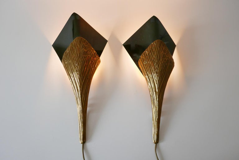 Set of two impressive Nefertiti wall lamps / sconces in bronze. Designed by Chrystiane Charles. Handmade by Charles Paris.  Executed in bronze and brass, each lamp needs 1 x E27 Edison screw fit bulb. Delivery without bulbs. It runs both on 110 /