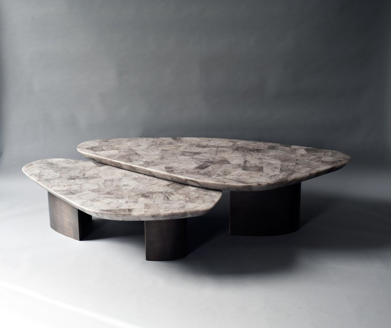 Set of 2ledge coffee table by DeMuro Das Dimensions: W 162.2 x D 80.7 x H 39.4 cm W 126.6 x D 68 x H 32.9 cm Materials: Quartz (Smokey) - Leather (Random)  Solid brass (Antique)  Dimensions and finishes can be customized.  DeMuro Das is an