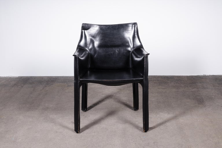 Set of 2 Mario Bellini 414 CAB armchairs. Made by Cassina in Italy in the 1980s.   Flexible steel frame covered with a skin of high quality black saddle leather. This elegant, versatile chair is equally suitable for the dining room, study or