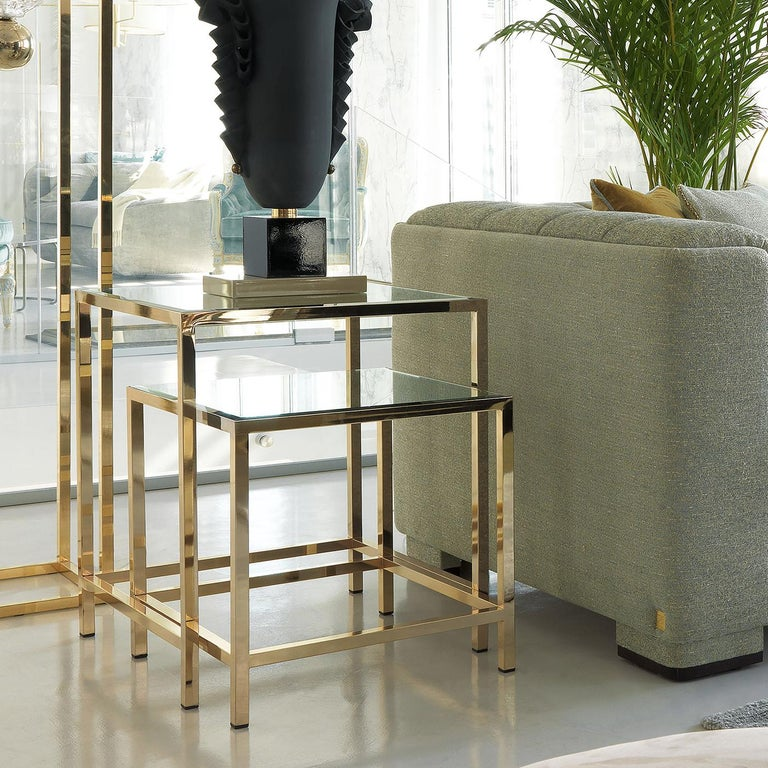 This elegant set of two side tables is an elegant exercise in minimalism and sophistication and will be a versatile addition to any home. Either in a Classic or contemporary living room, these two pieces can be displayed separately, or nested one