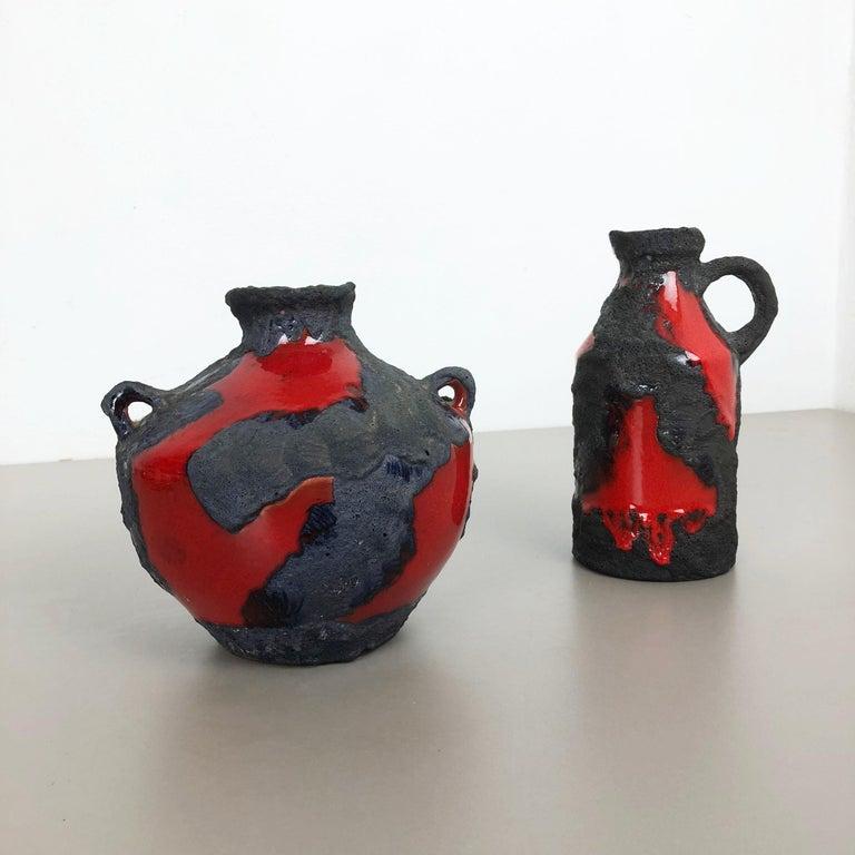 Article:  Ceramic fat lava vases set of 2   Producer:  Marei Ceramics, Germany   Decade:  1970s      Set of 2 original vintage Studio Pottery vases was produced in the 1970s by Marei Ceramics, Germany. Rare set of 2 different vases