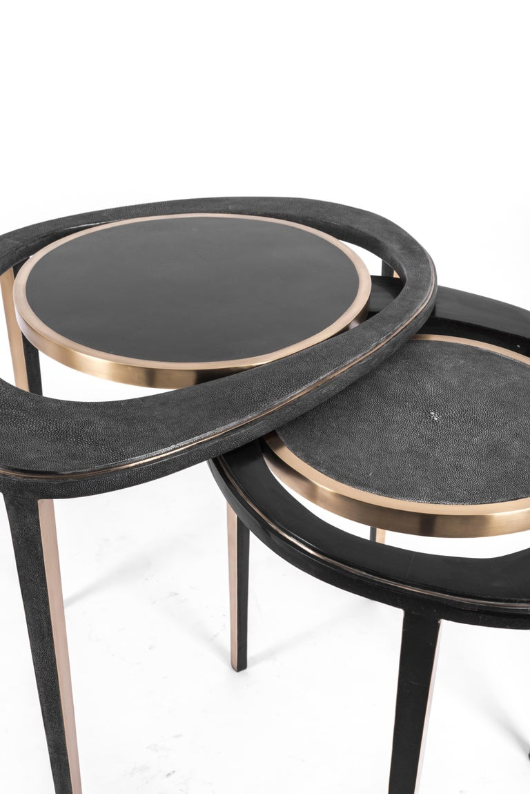 The set of 2 peacock nesting side tables are an iconic R&Y Augousti piece and one of their first designs. The piece is Minimalist and sculptural, with inspiration of course from the shape of exotic peacock feathers. The piece is inlaid in a mixture