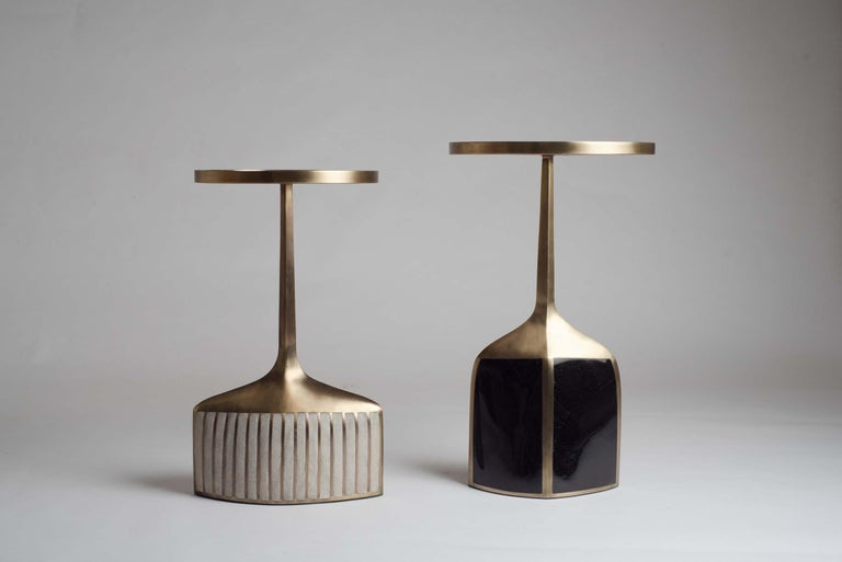 The pedestal side table in small and large are the perfect nesting accent pieces due to their sleek and light aesthetic. The large size is inlaid on the top surface with black shagreen, the bottom part a mixture of black pen shell and bronze patina