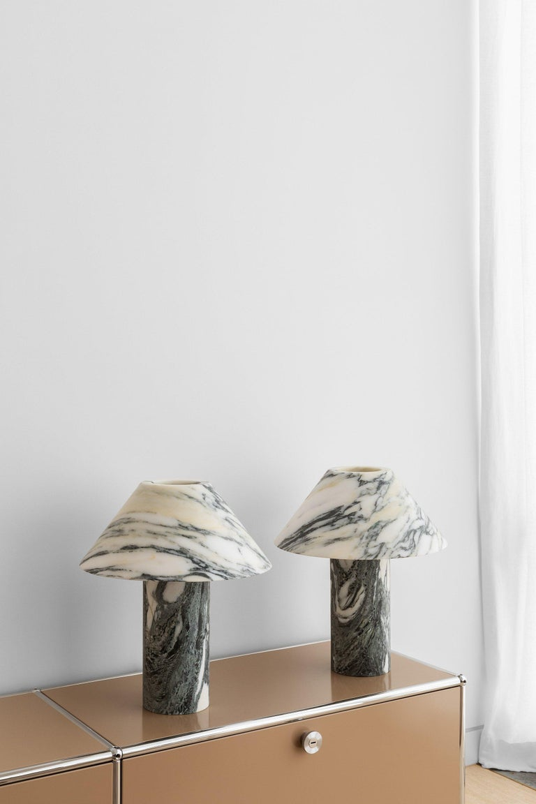 Pillar lamp in Arabescato marble by Henry Wilson Dimensions: Surface sconce are 40 x 12 x 35 cm Materials: Arabescato marble  Pillar lamp is hewn from two pieces of solid Arabescato marble. It is heavy and will require care in transport and a sturdy