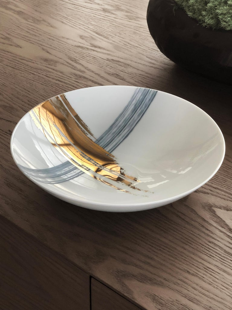 Larger quantities available upon request, with 8 weeks production time.  Description: Soup plate (2 pieces) Color: Blue and gold Size: 21 Ø x 5 H cm Material: Porcelain and gold Collection: Artisan Brush.