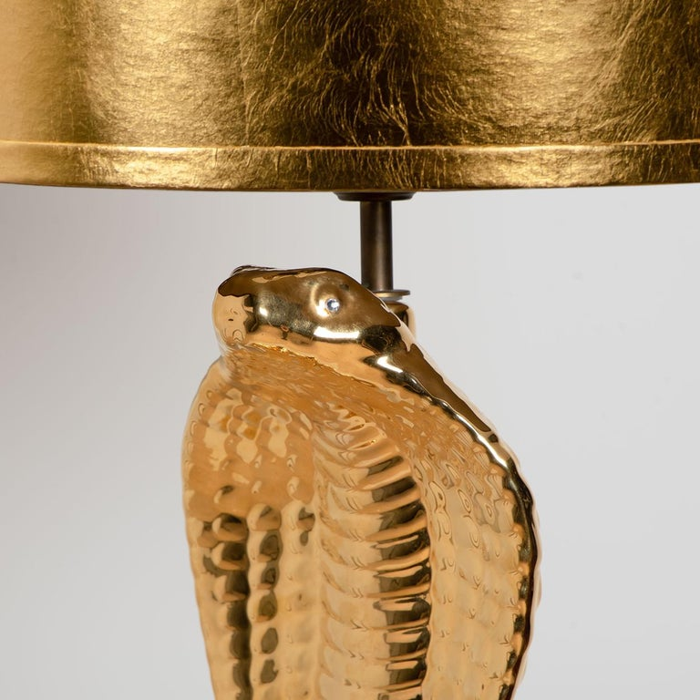 Pair of exceptional large table lamps. Unique gold-glazed ceramic table lamp in the shape of a cobra. A fine work signed by Tommaso Barbi, 1970 period. In absolutely perfect condition. With exceptional new custom made shades by René Houben. With