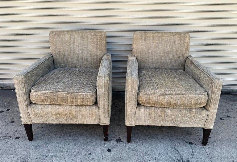 Beautiful pair of vintage chairs designed and manufactured in the USA in the early to mid-1960s.  The chairs have beautiful lines, they have rounded backs with slight slant, they are very comfortable, they retain the original upholstery and they