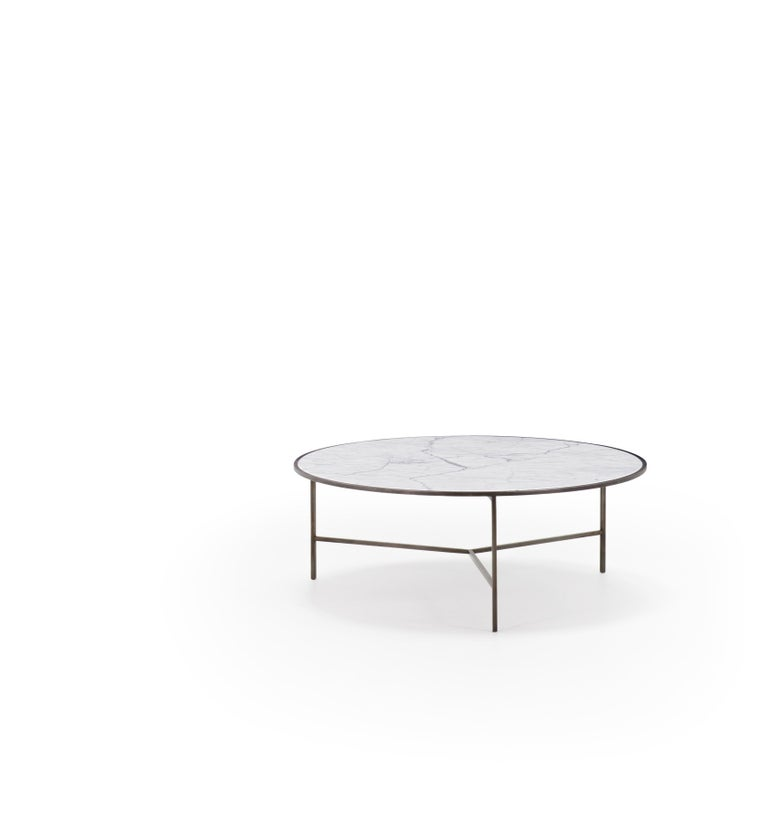 Available in stock and ready to ship, this duo features a stunning Carrara marble top nestled in a powder coated gray frame balanced with fine, yet sturdy iron legs.