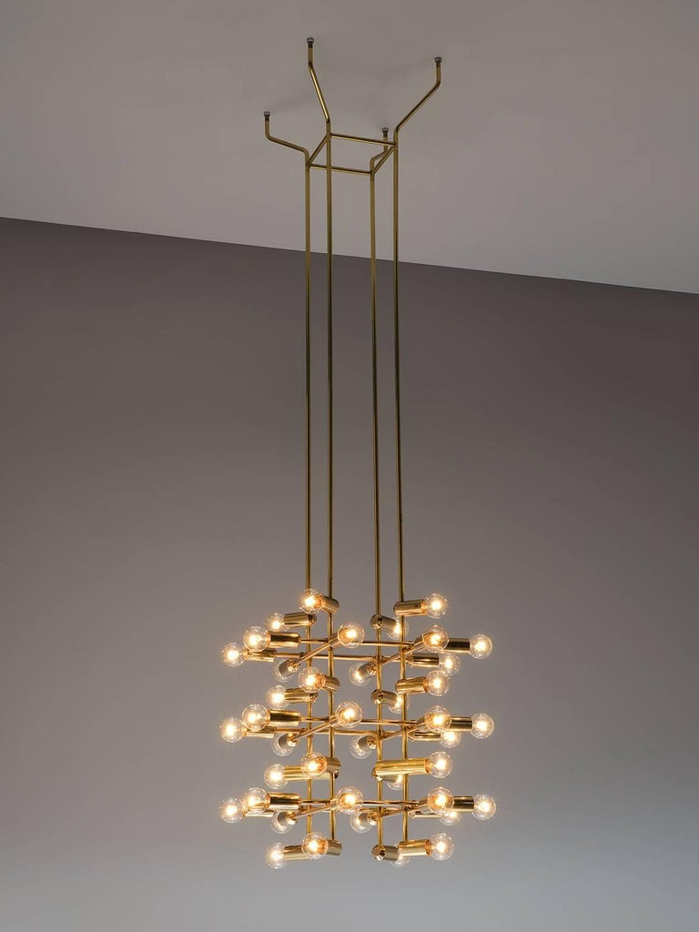 Set of 20 chandeliers in brass, Switzerland, 1960s.