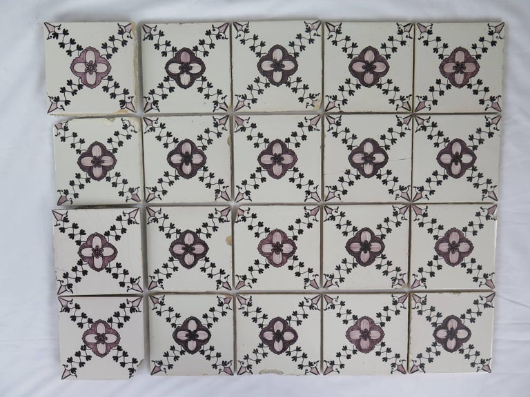 These are a very decorative and large set of 20 Dutch delft ceramic wall tiles, hand painted and dating to the early part of the 19th century.  The tiles are Dutch (Netherlands), Delft in origin and are of a manganese coloring.  Each tile is