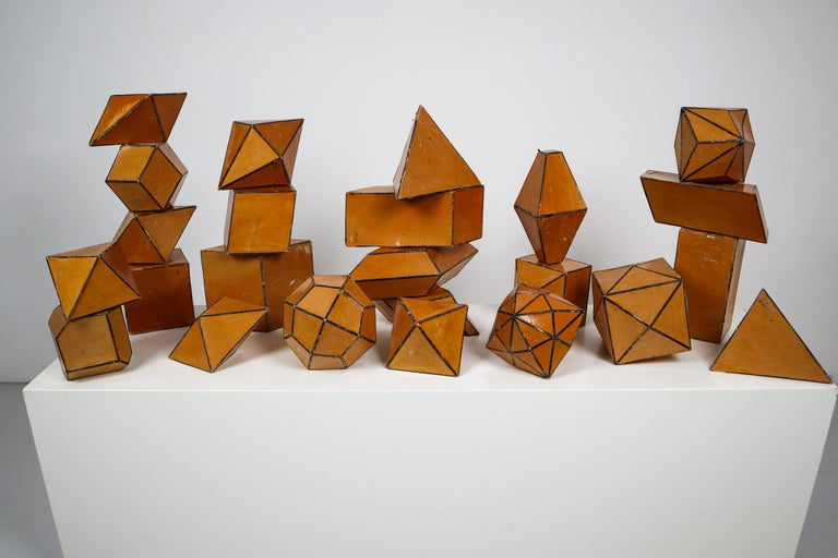 Set of 24 early 20th century cardboard crystal models with black edges. These crystal models used to be used as teaching material at school, to show students the difference in crystal shapes. Crystals are commonly recognized by their shape,