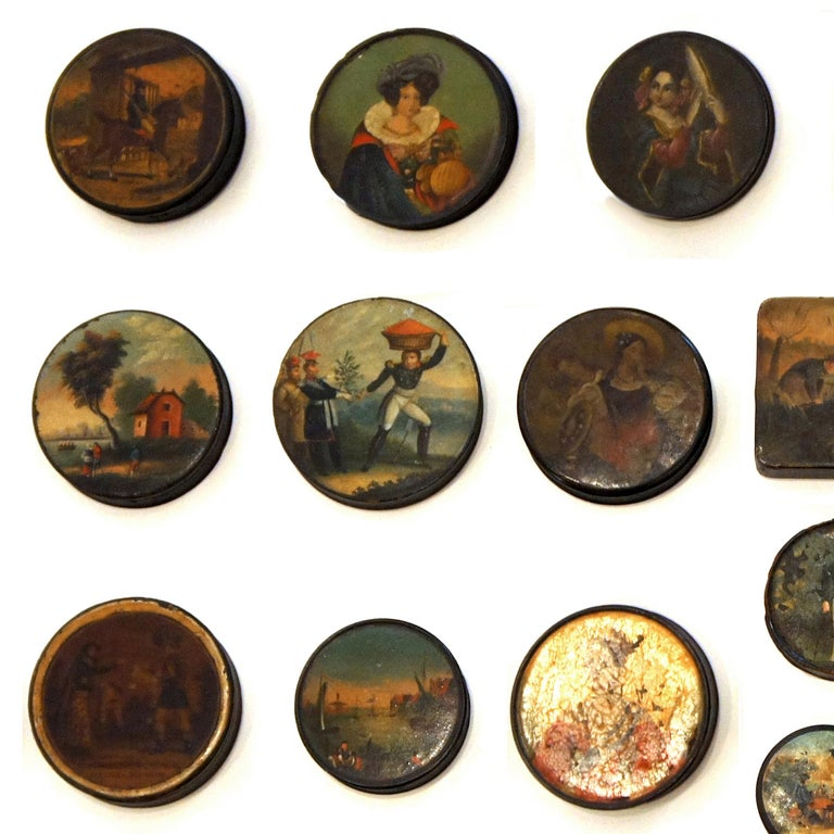 This diverse set of early 19th-century English painted snuff boxes, of various shapes and sizes, are finely decorated with a variety of subjects, including portraits of women, landscapes, hunting scenes, and whimsical vignettes.
