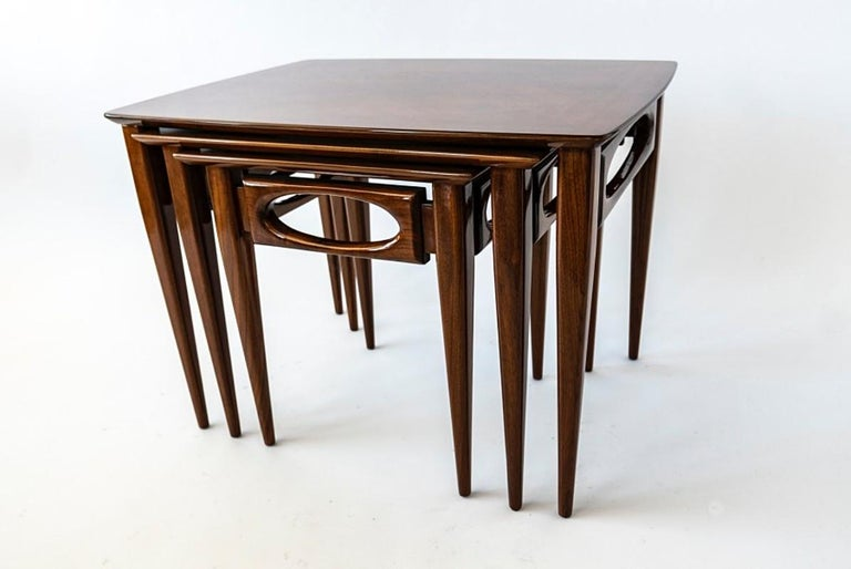 Set of 3 American modern walnut nesting tables, by American of Martinsville, 1950s.