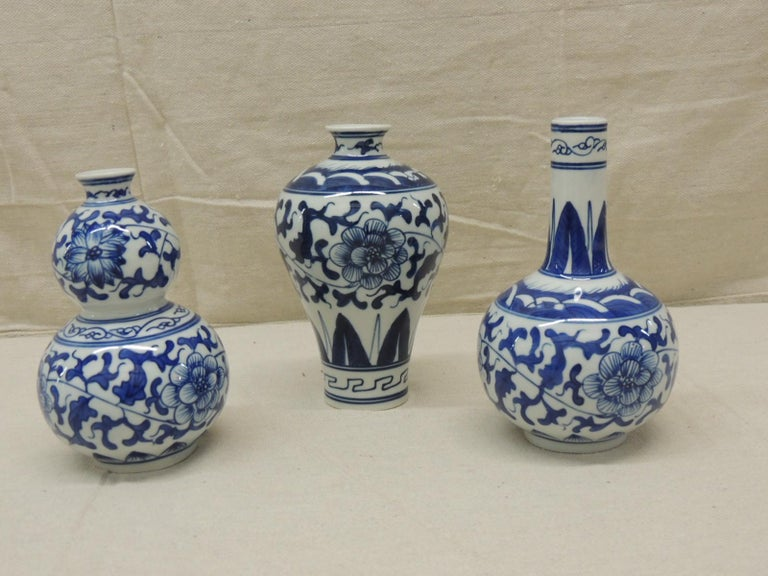 Set of (3) blue and white decorative vases. Purchased from Gumps in the 1990s, San Francisco. Size: 4