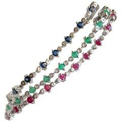 Set of 3 Bracelets in 18 Karat Gold, Rubies, Emeralds, Sapphires and Diamonds