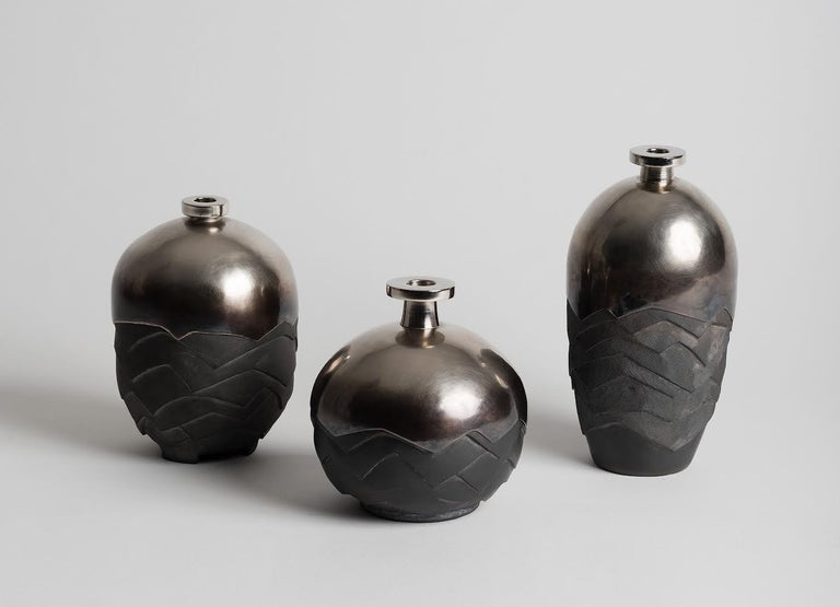 Set of 3 vases: Ceramic is realized with a smoked Japanese method and brass is hand hammered . Caroline Wagenaar is a French artist working metal and ceramic together. Her pieces are one of a kind.   Measures: H: 16 / 19 / 24 cm.