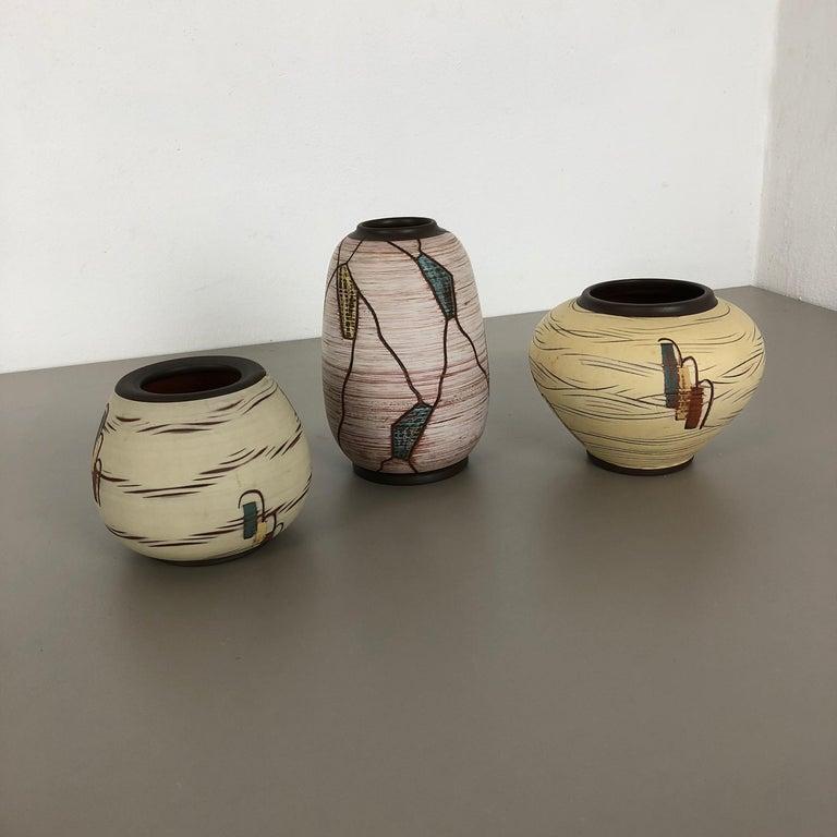 Article:   Pottery ceramic vases set of 3   Producer:   Sawa Ceramic, Germany   Design:   Franz Schwaderlapp   Decade:  1960s   Description:   Original vintage 1960s pottery ceramic vases set in Germany. High quality German