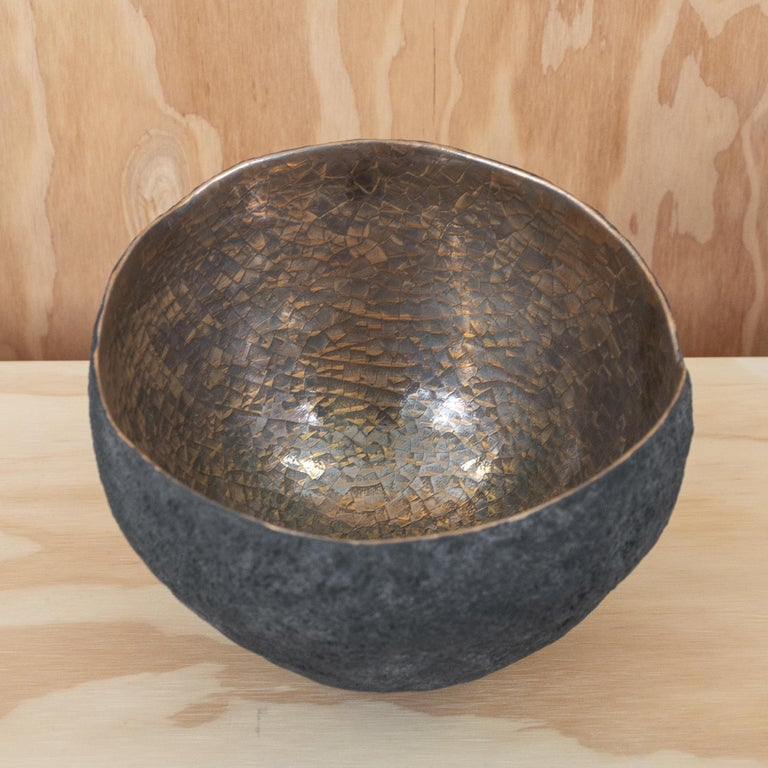 Set of 3 ceramics / centerpieces with gold and platinum interior.  Beginning with a ball of clay, Cristina Salusti pinches it into vessels and textures them with stone fragments. After multiple firing it is finally lustered with a mix of 22-karat