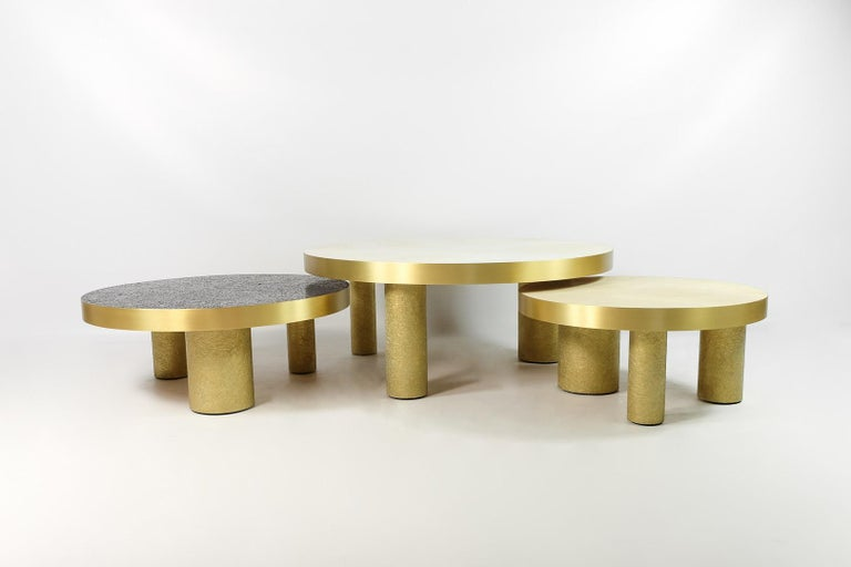 This set of 3 coffee tables is made of various inlaid materials. These modular tables can be setted up following your wishes. The center piece is covered with a polished white rock crystal marquetry, the side tables are inlaid with natural