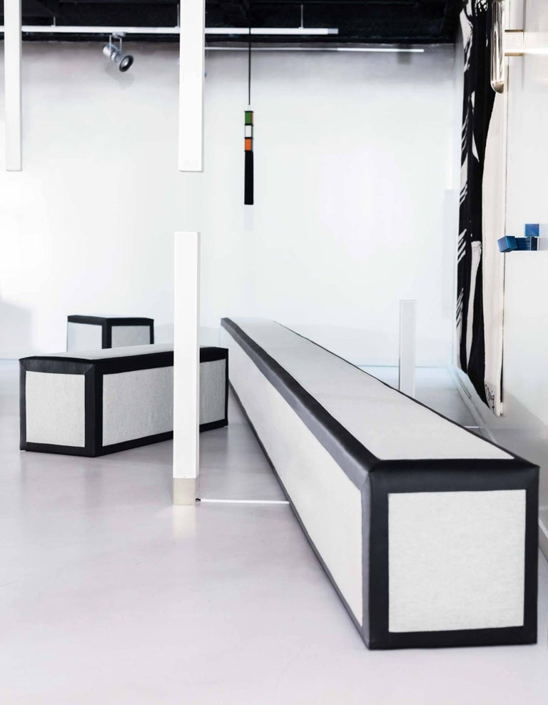 This set of three benches is a great addition to any space. Each piece is made with black leather from Garrett Leather, and fabric from Holly Hunt's