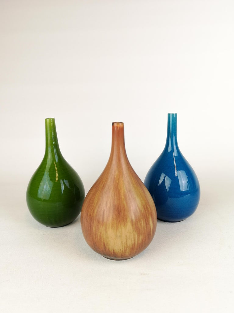 A set of 3 wonderful shaped and glazed vases. They are manufactured at Rörstrand Sweden in early 1960s and designed by CHS Carl Harry Stålhane.