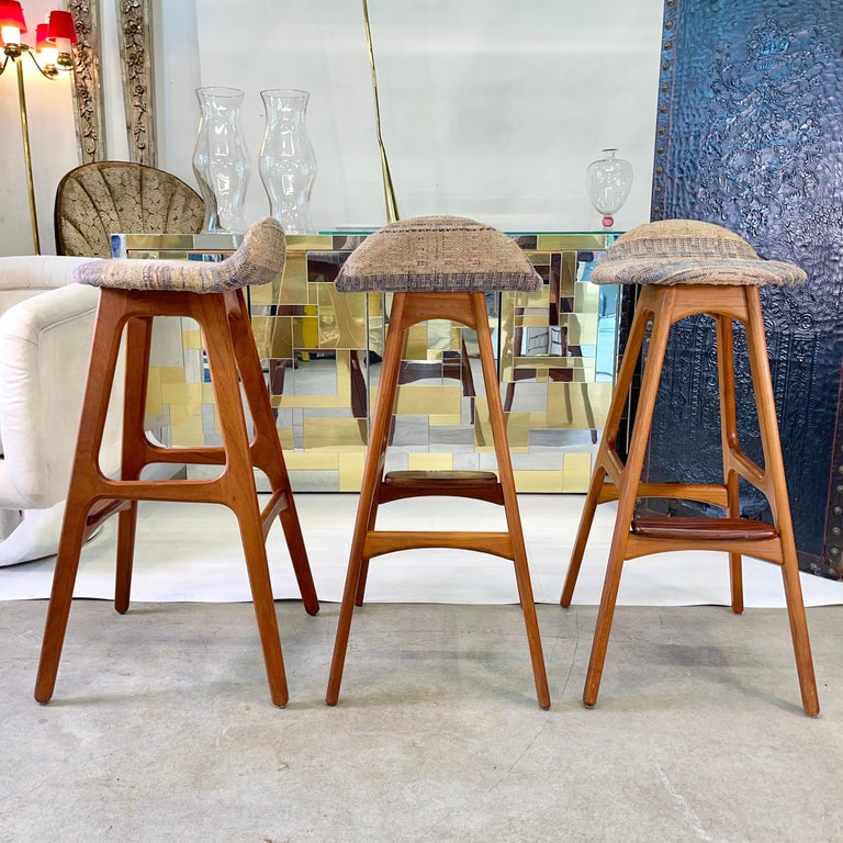 Original 1960s vintage O. D. 61 bar stools designed by Erik Buch (1923-1982) and made in Denmark by Oddense Maskinsnedkeri A-S. Teak frame with a rosewood foot rest. Woven textile upholstered seats in clean condition. If requested we can have