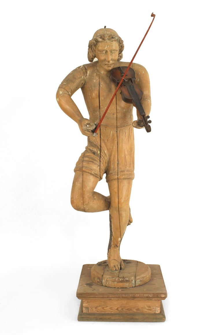 Set of 3 Italian Renaissance style (19th century) stripped large figures/statues playing musical instruments.