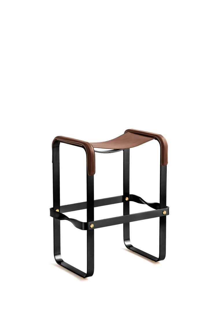 The Wanderlust contemporary counter stool belongs to a collection of minimalist and serene pieces where exclusivity and precision are shown in small details such as the hand-turned metal nuts and bolts that fix the leather surfaces, that go